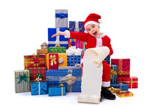 Little Christmas boy along gifts with wishlist Royalty Free Stock Photos