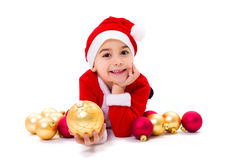 Little Christmas boy holding ornament Stock Photo