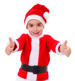 Little Christmas boy showing thumbs up Stock Images