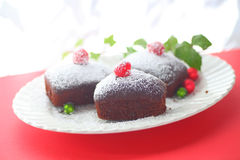 Little Christmas cakes with powdered sugar and copy space Royalty Free Stock Photography