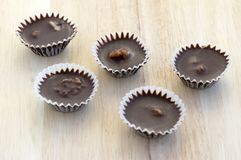 Little Christmas chocolate cupcakes with grounded walnuts and rum stock images