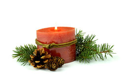 Little Christmas composition, a burning candle, fir ,cones. / Is Royalty Free Stock Image