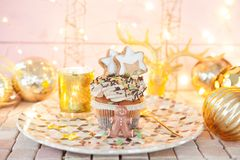 Little christmas cupcake. With sugar decorations and cream frosting stock photo