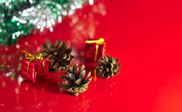 Little Christmas gifts boxes and cones Royalty Free Stock Image
