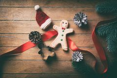 Little Christmas gingerbread man cookie with Santa Claus hat Royalty Free Stock Images