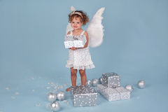 Little christmas girl. Small girl with wings brings gifts of Christmas Royalty Free Stock Image