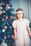 Little christmas girl Stock Images