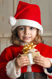Little Christmas girl with a present Stock Photography