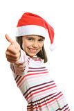 Little Christmas girl showing thumbs up Royalty Free Stock Image