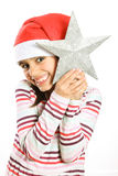 Little Christmas girl with tree star Stock Photography
