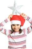 Little Christmas girlholding a tree star on head Royalty Free Stock Photos