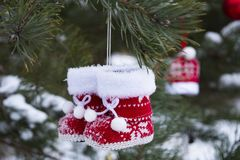 Little Christmas knitted red boots royalty free stock photo