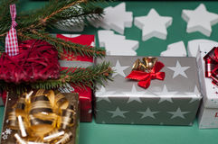 Little christmas presents. With chistmas decoration and with a branch of a Christmas tree Royalty Free Stock Images