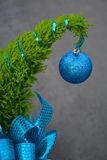 Little christmas tree with blue ornament Stock Photography