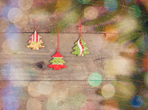 Little Christmas tree toys on pine branch on wood table Royalty Free Stock Images
