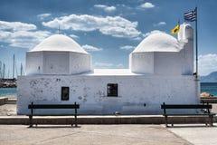 Little church in Aegina harbor, Greece. Little white orthodox church in Aegina harbor, Greece stock photos