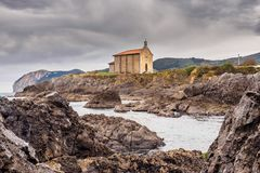 Little church in the coast of the Basque Country. Mundaca village in the north coast of Spain stock images