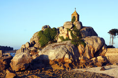 Little church on a pink granite rocks Stock Photography