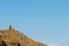 Little church on top of a peak. Italian alps Stock Photos