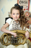 Little circus actress with tuba. Portrait of a little circus actress with tuba Royalty Free Stock Photos