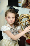 Little circus actress with tuba. Portrait of a little circus actress with tuba Royalty Free Stock Photo