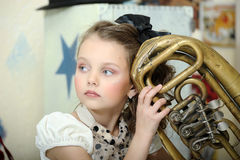 Little circus actress with tuba. Portrait of a little circus actress with tuba Stock Image