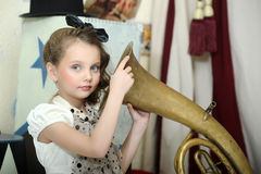 Little circus actress with tuba. Portrait of a little circus actress with tuba Stock Images