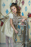 Little circus actress with tuba. Portrait of a little circus actress with tuba Stock Photo