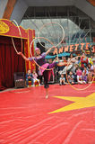 Little circus hola hoop dancer in disney village Royalty Free Stock Photo