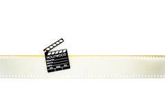Little clapper board on empty 35 mm movie filmstrip isolated Royalty Free Stock Photography