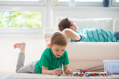 Little clever boy play with blocks Stock Photos