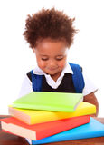 Little clever boy. Portrait of little clever boy isolated on white background, cute african schoolboy reading book, back to school concept stock photo