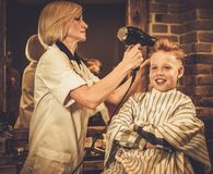 Little client in a barber shop Stock Photos