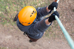 Little climber hanging on a rope Royalty Free Stock Image