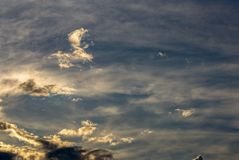 Little clouds above the mountains at sunset royalty free stock photos
