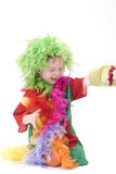 Little clown. Colorful dressed child, holiday clown, isolated over white Royalty Free Stock Photography