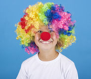 Little clown. Boy on blue background Stock Images