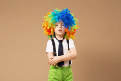 Little clown boy with colorful hair Royalty Free Stock Image