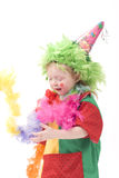 Little clown II. Colorful dressed child, holiday clown, isolated over white Royalty Free Stock Photography