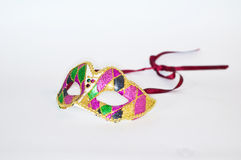 Little color mask with sequins and diamonds. Color Venetian mask in pink green and white Stock Image