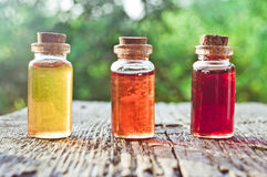 Little colored bottles with magic potion Royalty Free Stock Photo