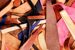 little colored scraps of leather, natural texture background royalty free stock photo