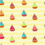 Little colored ships on striped background Stock Photos