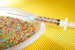 Little colorful candy syringe Stock Image