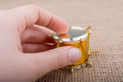 Little colorful toy drum  in hand Stock Photography