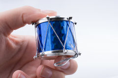 Little colorful toy drum  in hand Royalty Free Stock Photo