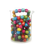 Little colorful wooden balls in a glass recipient Stock Photography