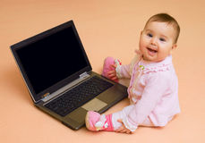Little computer genius baby girl with laptop Stock Photography