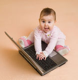 Little computer genius baby girl with laptop Royalty Free Stock Photography