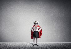 Girl power concept with cute kid guardian in empty room. Mixed m royalty free stock photos
